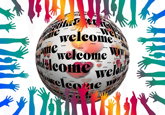 Welcome globe and multi-coloured hands