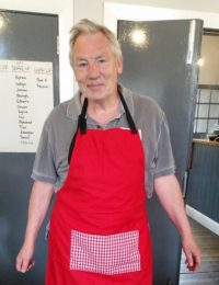 Paul modelling our Big Lunch volunteer apron