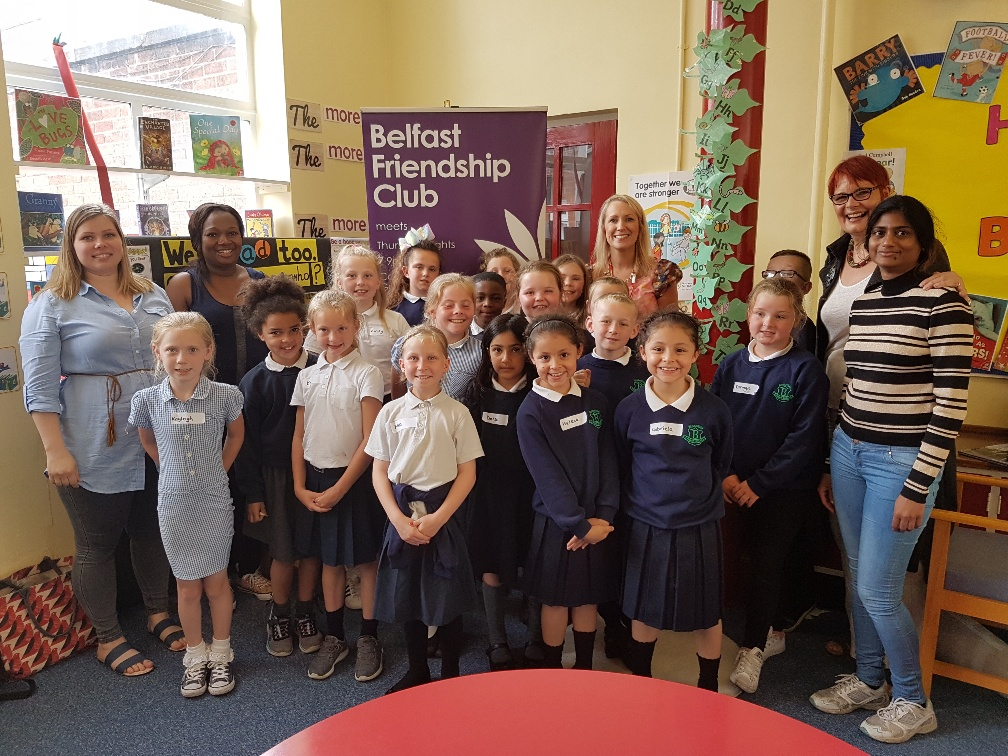 Small Worlds hosts with pupils from Northern Ireland's first School of Sanctuary Blythefield Primary School and their teacher
