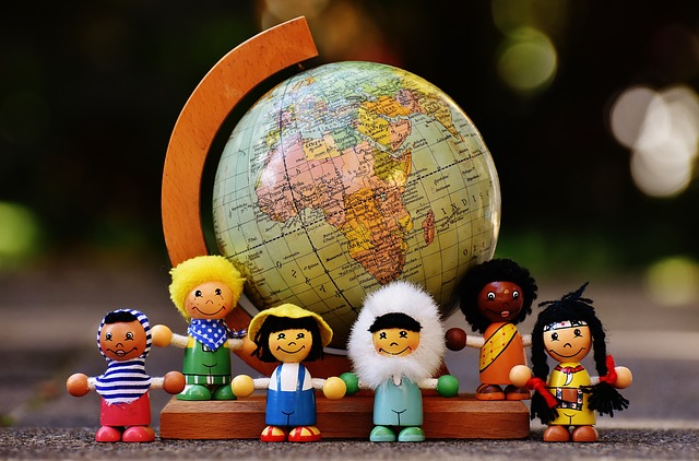 Dolls of different nationaliities and globe